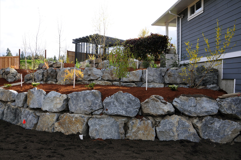 Rock retaining wall retaining walls and rocks on pinterest for Landscaping rocks victoria bc