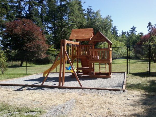 wooden playground and swings victoria cowichan valley gulf islands
